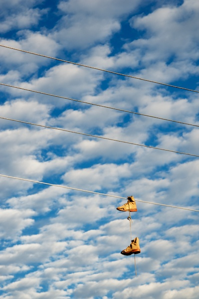 Shoes hanging from power lines in early morning in Cerocahui, Mexico by Ralph Velasco.
