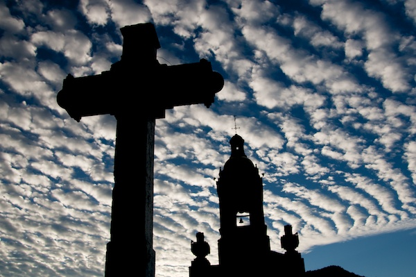 Morning clouds and church silhouette in Cerocahui, Mexico by Ralph Velasco.