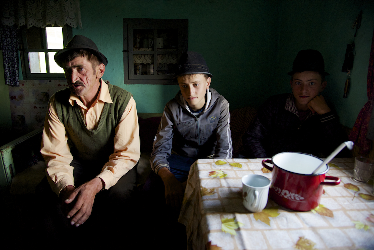 Dinu, Nicu and Gabi Inside Family Home at Sheep Fold near Sibiu, in Romania - Copyright 2014 Ralph Velasco