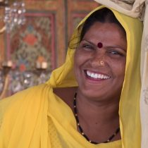 Woman in Yellow Smiling at Camera Slider - Jaipur, India - Copyright 2017 Ralph Velasco