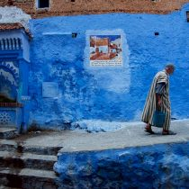 man-walking-with-bucket-against-blue-wall-chefchaouen-morocco-copyright-2015-ralph-velasco