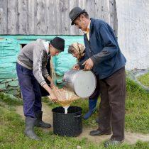 parents-and-son-filtering-milk-through-handkerchief-jina-transylvania-romania-copyright-2014-ralph-velasco
