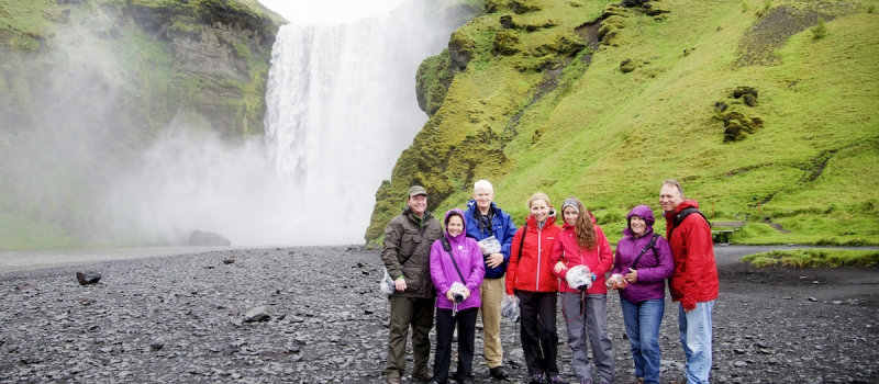 Group in Front of Waterfall in Skogar, Iceland by Ralph Velasco